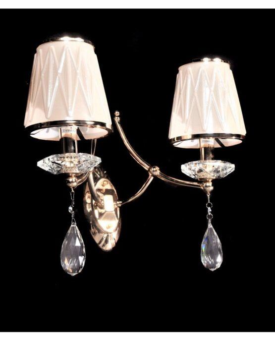 applique elegante vista lateralmente con due punti luce e cristalli