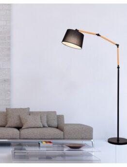 lampada da terra vicino al divano per arredare il soggiorno