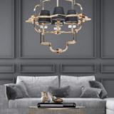 lampadario sospensione paralumi tessuto e struttura oro con decorazioni in cristallo