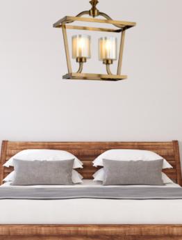 lampada a sospensione color ottone per camera da letto