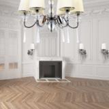 salotto illuminato con lampadari e applique coordinate stile classico colore bianco crema