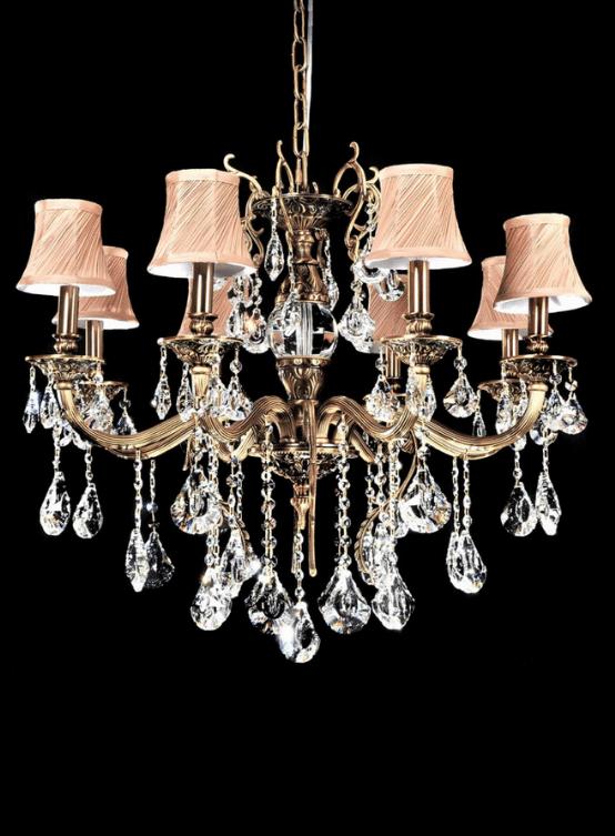 lampadari classici elegante con cristallo e struttura ottone con catena