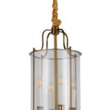 lampadario 4 luci con candele dentro il paralume di vetro