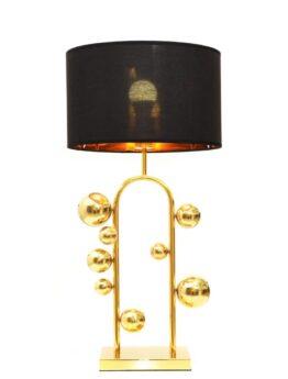 lampada da tavolo e scrivania dorata con paralume nero